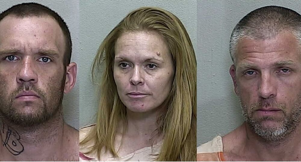 Brandon Hayley, Mary Durham and Lucian Evans appear in mugshots taken at the Marion County Jail in 2019.