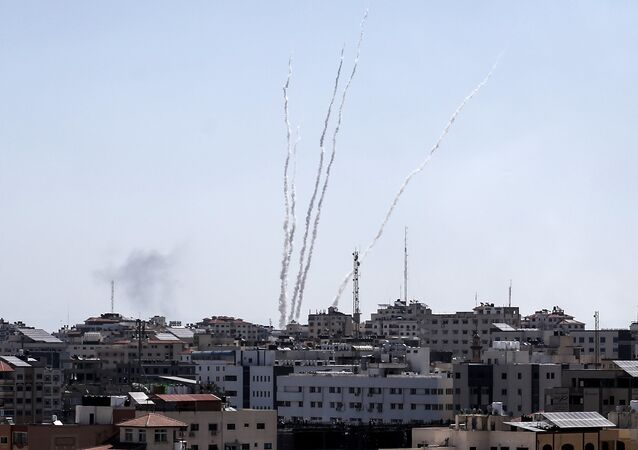 A picture taken from the Gaza Strip on May 4, 2019 shows missiles being launched toward Israel. A barrage of around 50 rockets was fired at Israel from the Gaza Strip on Saturday and dozens were intercepted by air defences, the Israeli army said.