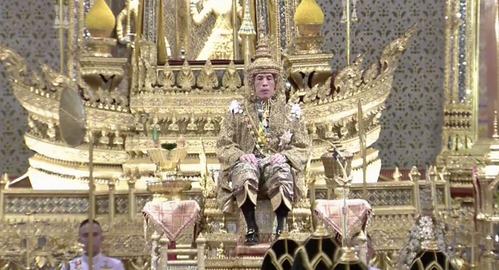 Thailand's King Maha Vajiralongkorn sits on the throne