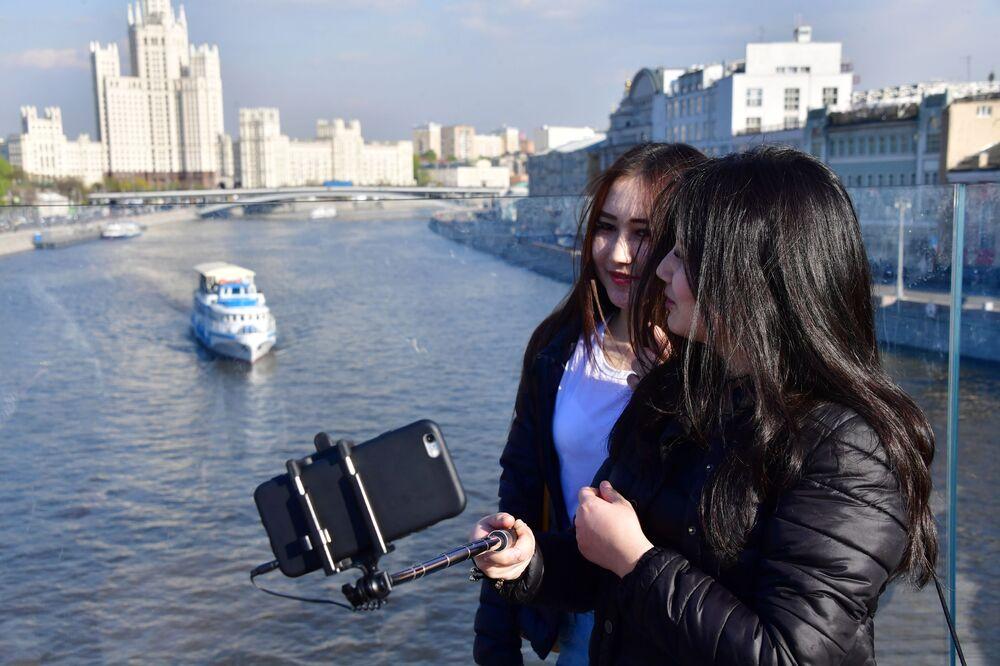 Girls Take Selfies on the Bridge in Zaryadye Park in Moscow