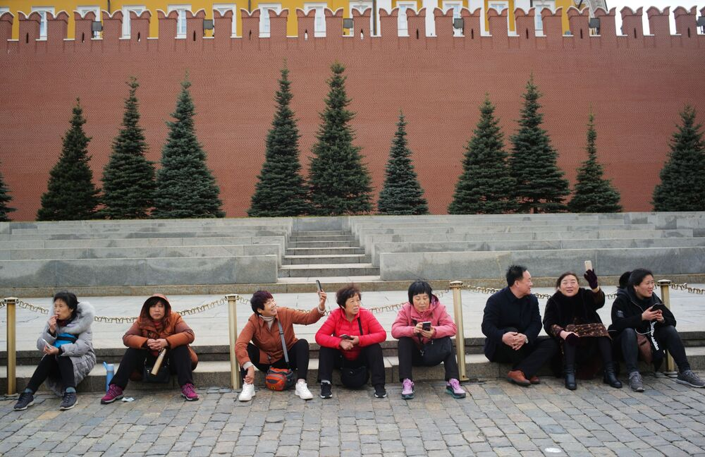 Tourists Take Pictures at the Red Square