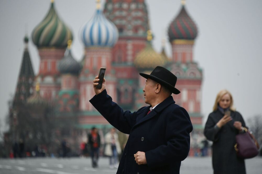 Tourist Takes Picture at the Red Square in Moscow