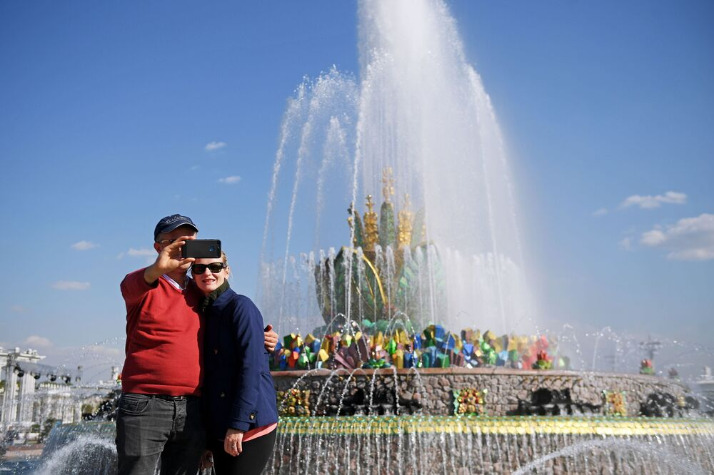 Tourists Take Pictures at VDNH