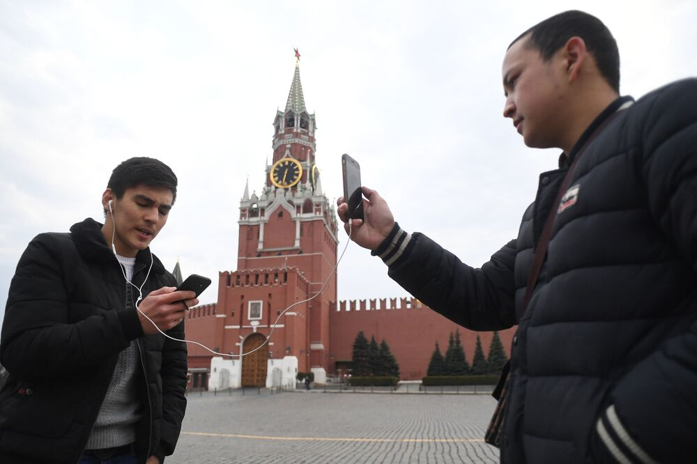 Young People Taking Pictures at the Red Square