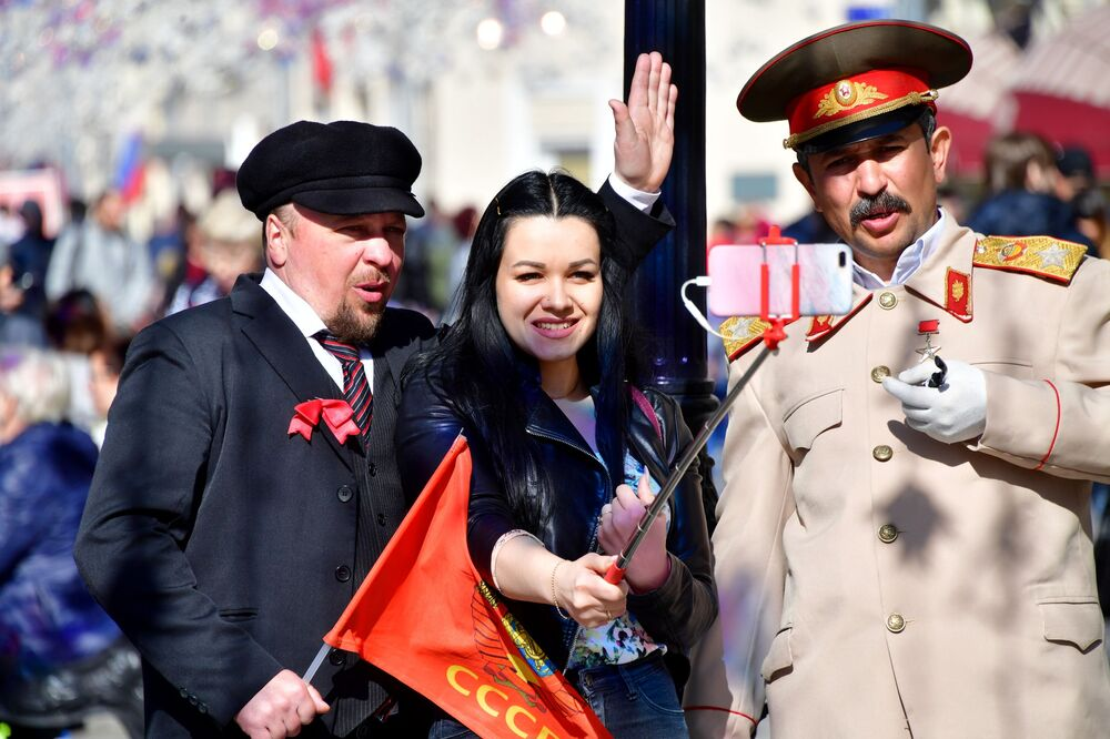 Girl Takes a Picture with Men Dressed Like Lenin and Stalin at Nikolskaya Street