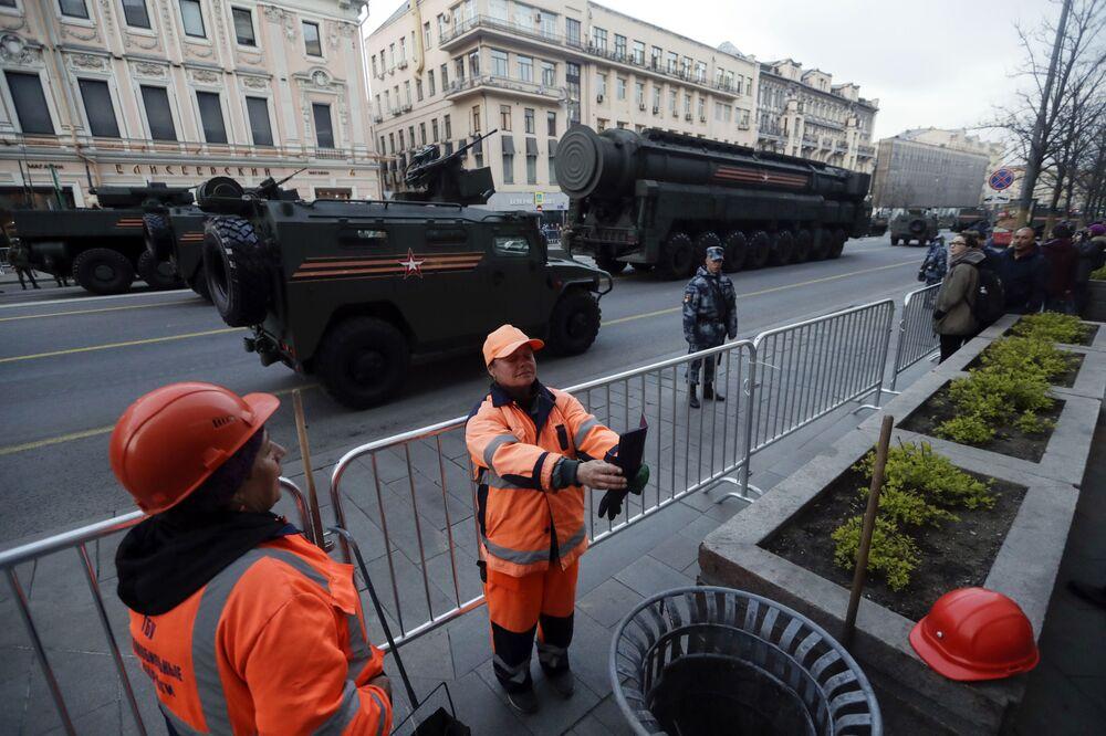 A Municipal Worker Takes a Selfie as Russian Military Vehicles are Parked in a Street