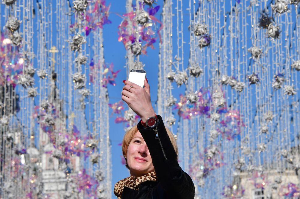 Woman Taking a Selfie at Nikolskaya Street in Moscow