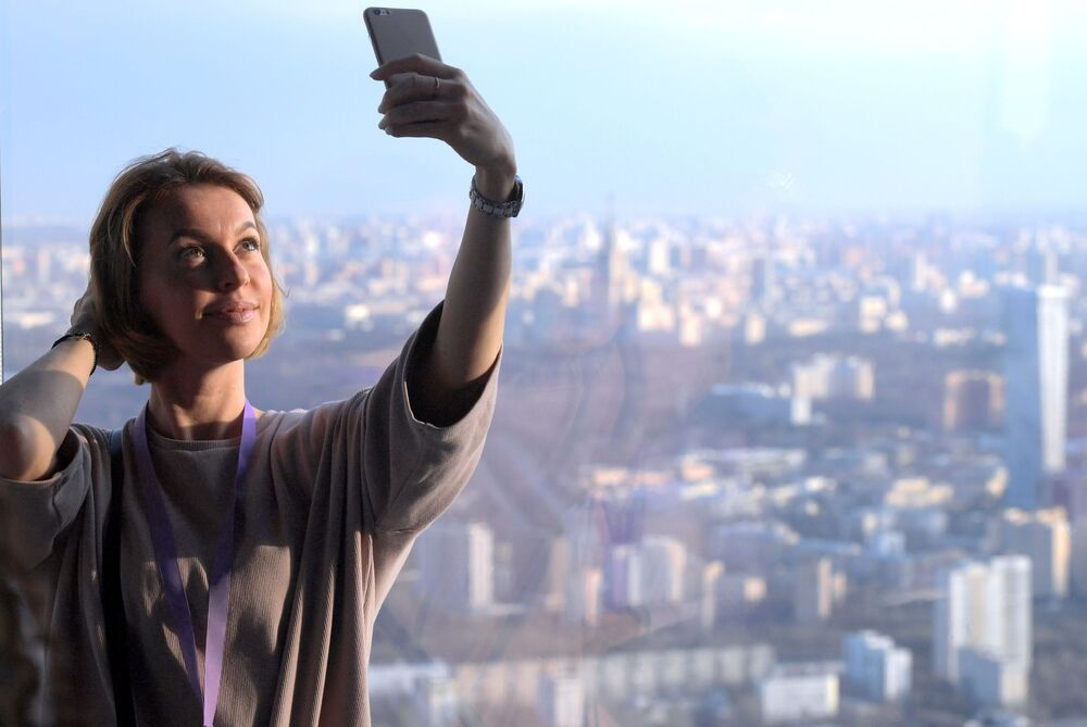 Moscow City Visitor Takes a Selfie on the Observation Deck in Moscow