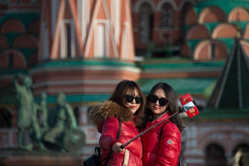 Girls Taking Pictures at the Red Square