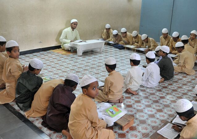 Muslim students recite from the Quran in a classroom