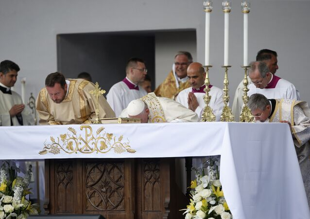 Pope Francis kisses the altar as he celebrates Mass in Knyaz Alexandar Square in Sofia, Bulgaria, Sunday, May 5, 2019