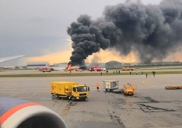 A passenger plane is seen on fire after an emergency landing at the Sheremetyevo Airport outside Moscow, Russia May 5, 2019