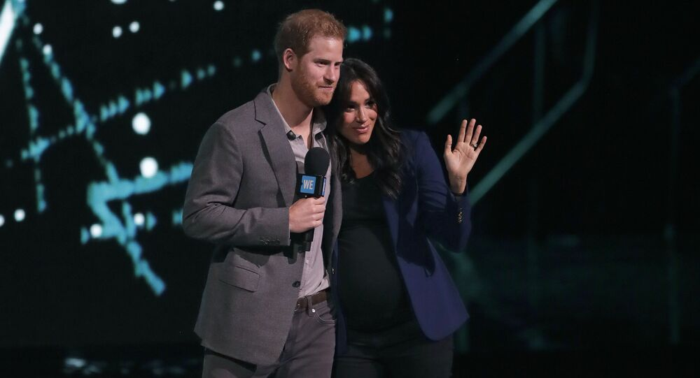 Meghan, the Duchess of Sussex, is brought on stage by Britain's Prince Harry during his speech at WE Day UK, a global initiative to encourage young people to take part in positive social change at the SSE Arena in Wembley, London, Wednesday, March 6, 2019