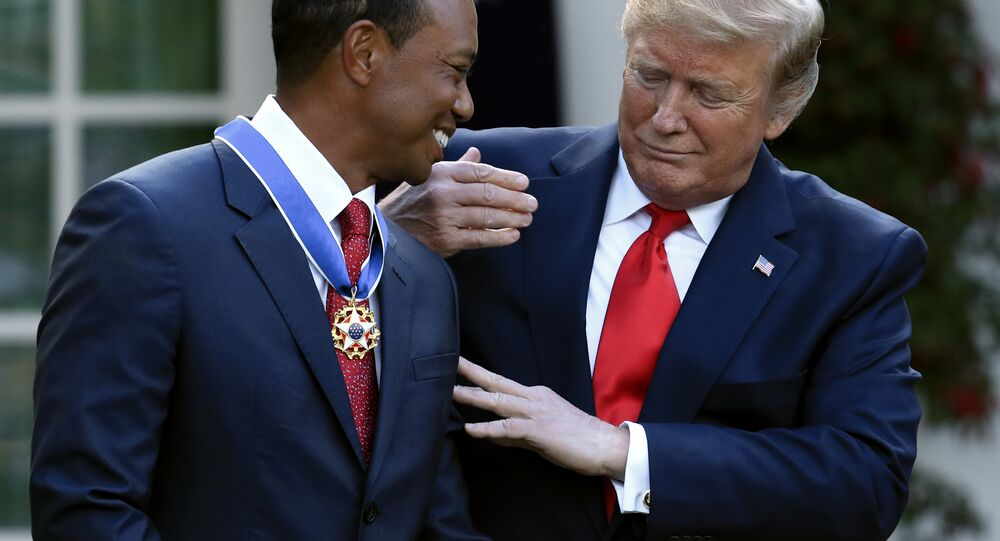 President Donald Trump presents the Presidential Medal of Freedom to Tiger Woods during a ceremony in the Rose Garden of the White House in Washington, Monday, May 6, 2019. (AP Photo/Manuel Balce Ceneta)