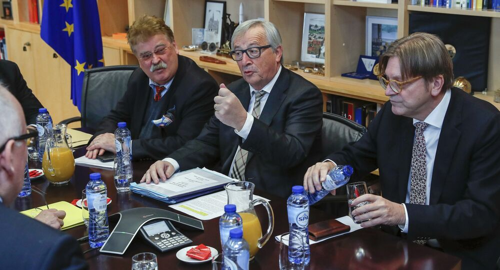 European Commission President Jean-Claude Juncker, center right, meets with members of the Brexit steering committee European Parliament chief Brexit official Guy Verhofstadt, right, and Member of European Parliament Elmer Brock at EU headquarters in Brussels on Monday, Dec. 4, 2017.