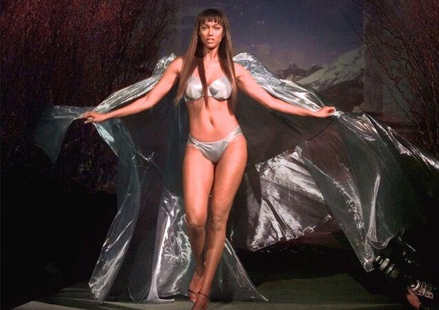 Model Tyra Banks wears a satin bikini at the Victoria's Secret fashion show Wednesday, Feb. 3, 1999 in New York.