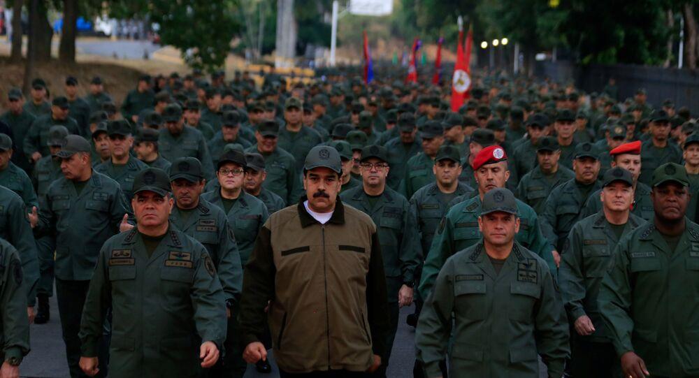 Venezuela's President Nicolas Maduro walks next to Venezuela's Defense Minister Vladimir Padrino Lopez and Remigio Ceballos, Strategic Operational Commander of the Bolivarian National Armed Forces