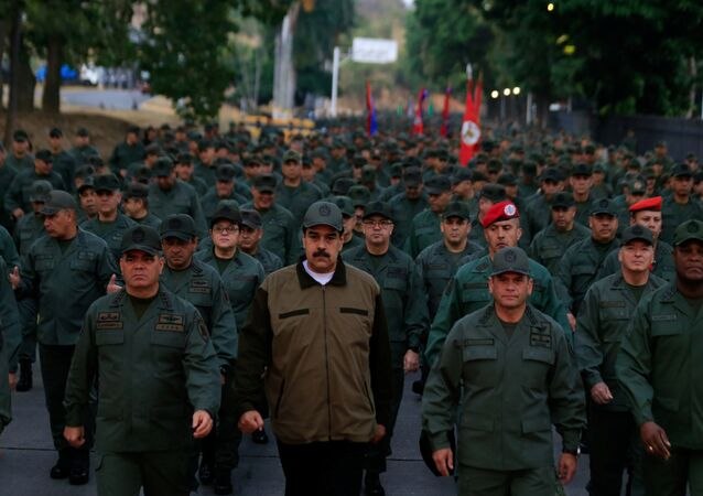 Venezuela's President Nicolas Maduro walks next to Venezuela's Defense Minister Vladimir Padrino Lopez and Remigio Ceballos, Strategic Operational Commander of the Bolivarian National Armed Forces