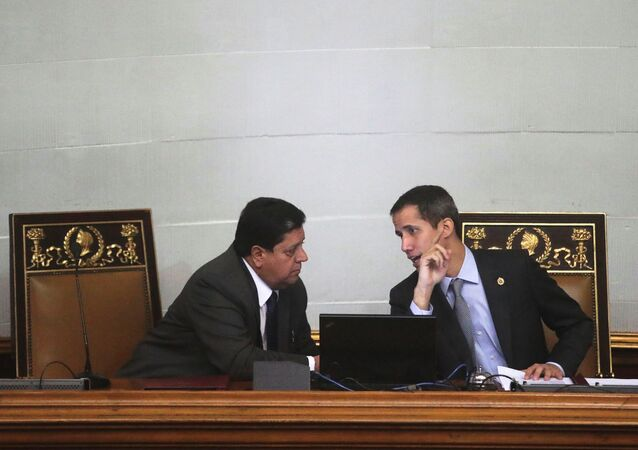 Venezuelan opposition leader Juan Guaido, who many nations have recognised as the country's rightful interim ruler, talks to Edgar Zambrano, the assembly vice president, in a session of the National Assembly in Caracas, Venezuela March 6, 2019. Picture taken March 6, 2019. REUTERS/Ivan Alvarado