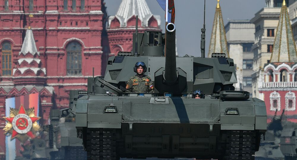 Russian T-14 Armata main battle tanks roll down the Red Square during a rehearsal for the Victory Day parade in Moscow on 9 May, 2019