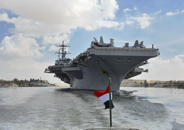 The USS Abraham Lincoln sails south in the Suez canal near Ismailia, Thursday, May 9, 2019