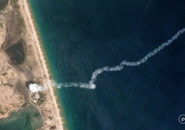 The trail of a suspected missile is seen on a commercial satellite image captured by Planet over the Hodo Peninsula in North Korea
