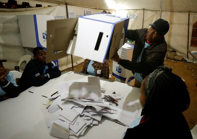 FILE PHOTO: An election official empties a ballot box as counting begins after polls closed in Alexandra township in Johannesburg, South Africa, May 8,2019. REUTERS/Mike Hutchings