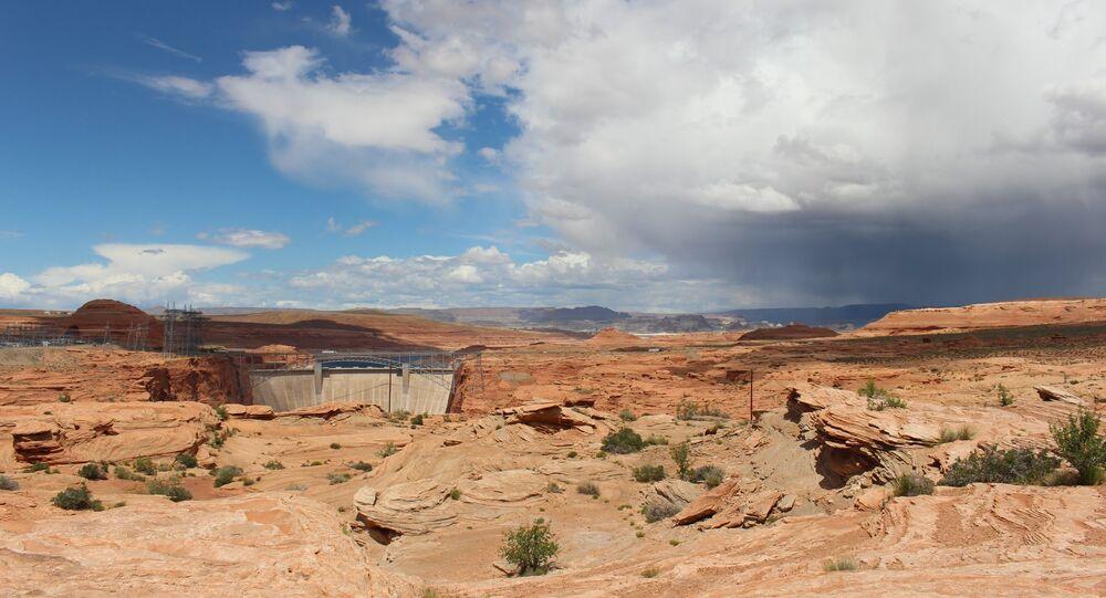 A storm creeps over the mesas surrounding Glen Canyon as blue skies fade to gray.