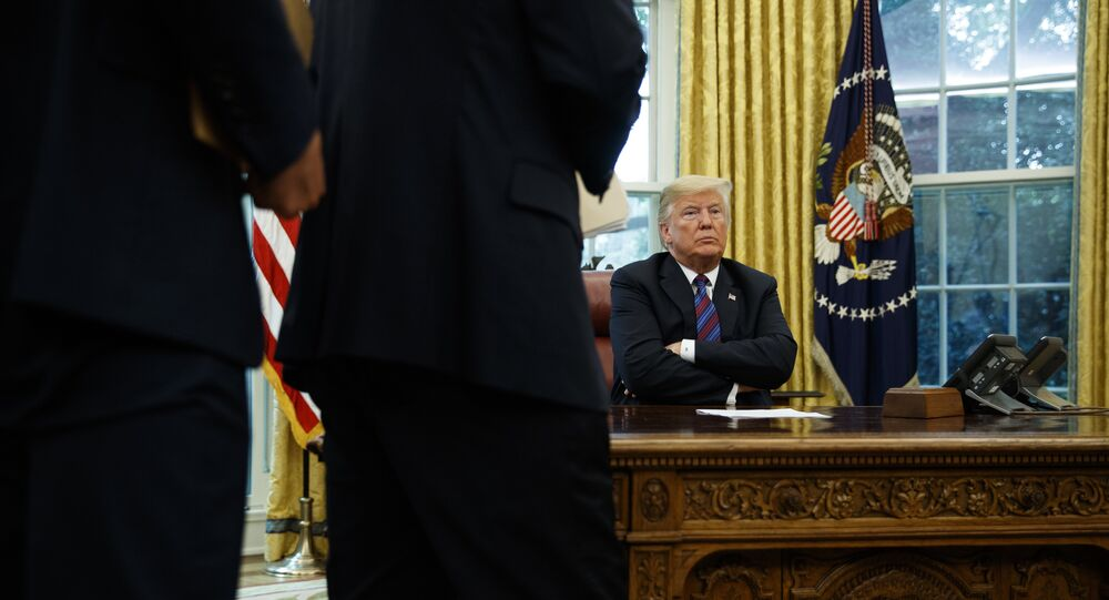 President Trump at his desk by the telephone, file photo.