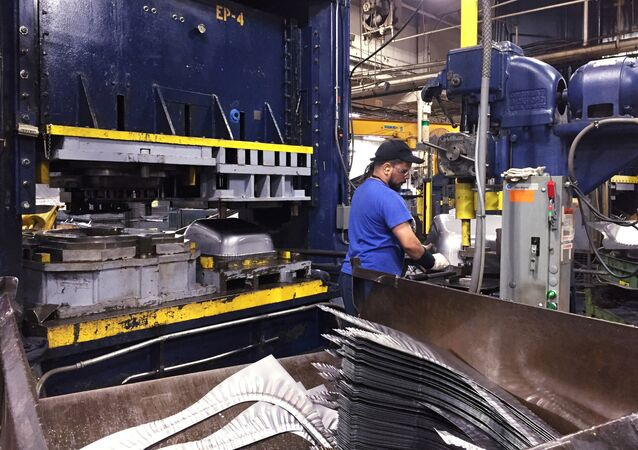 FILE PHOTO: A production line employee works at the AMES Companies factory, the largest wheelbarrow factory in the world, in Harrisburg, Pennsylvania, US on June 29, 2017.