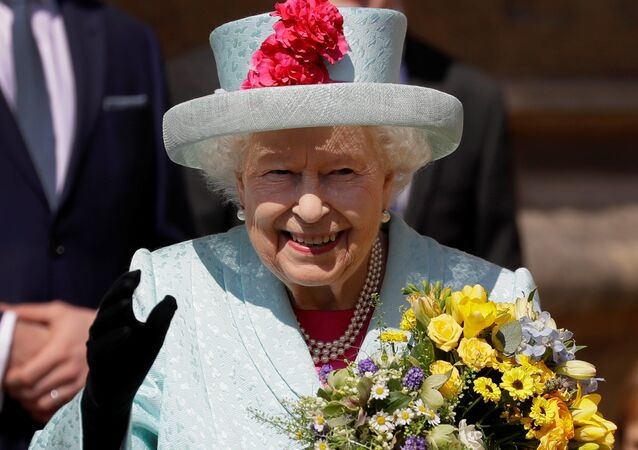 Britain's Queen Elizabeth waves to the public as she leaves the Easter Mattins Service at St George's Chapel at Windsor Castle, Britain April 21, 2019.