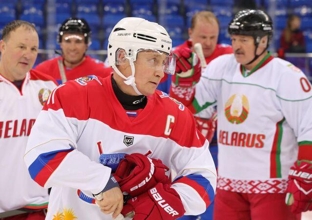 Russian President Vladimir Putin plays hockey in Sochi. Right: Belarusian President Alexander Lukashenko. 15 February 2019