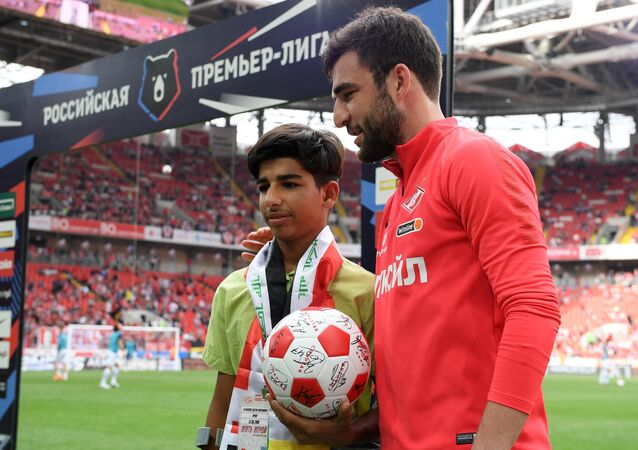 Iraqi boy Qassem Qadim, who is captured on the photograph titled Desire for Life that won gold in the Sports category of the 2018 Andrei Stenin International Press Photo Contest, attended on Sunday a Russian Premier League match between Spartak and Ufa football clubs.