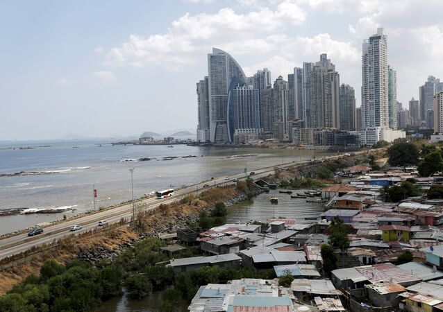 A low income neighbourhood is seen as the city skyline is seen in the background in Panama City, April 4, 2016