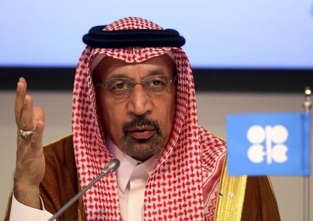 FILE - In this June 23, 2018 file photo, Saudi Energy Minister Khalid al-Falih attends a news conference in Vienna, Austria. Saudi Arabia said on Thursday, Aug. 23, 2018 that it remains committed to an initial public offering of the state-run oil behemoth Saudi Aramco despite delays and growing speculation it may never be listed. (AP Photo/Ronald Zak, File)