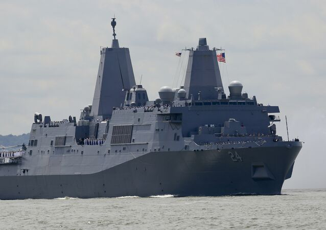 The USS Arlington, from Norfolk, Va., a San Antonio-class amphibious transport dock with several hundred Marines from Camp Lejeune, N.C., arrives on the Hudson River to kickoff 2018 Fleet Week New York, Wednesday May 23, 2018, in New York