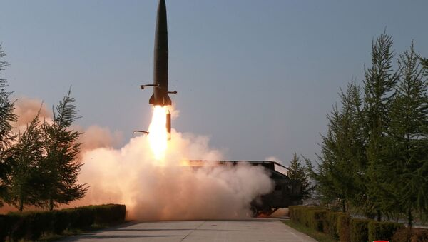 A missile is seen launched during a military drill in North Korea, in this May 10, 2019 photo supplied by the Korean Central News Agency (KCNA) - Sputnik International