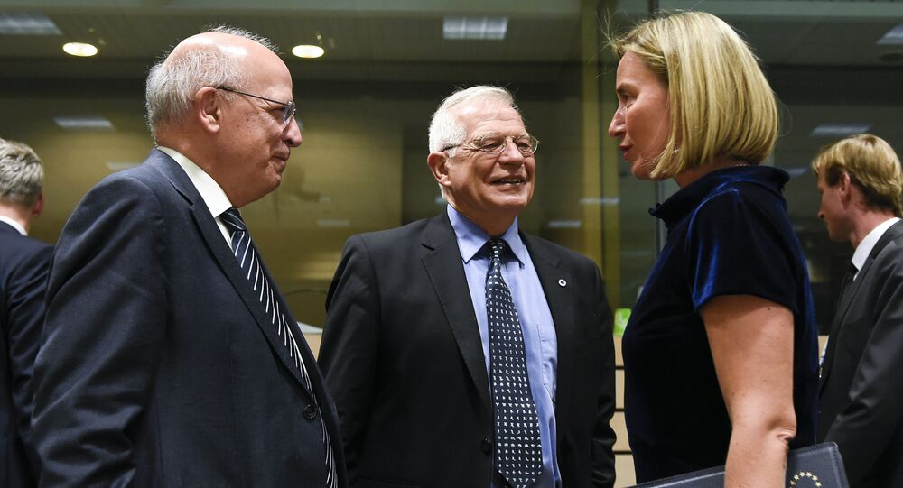 Portuguese Foreign Minister Augusto Santos Silva (L) speaks with Spanish Foreign Minister Josep Borrell (C) speak with EU's High Representative for Foreign Affairs and Security Policy Federica Mogherini during a EU Foreign Affairs Council meeting at the EU headquarters in Brussels on May 13, 2019.