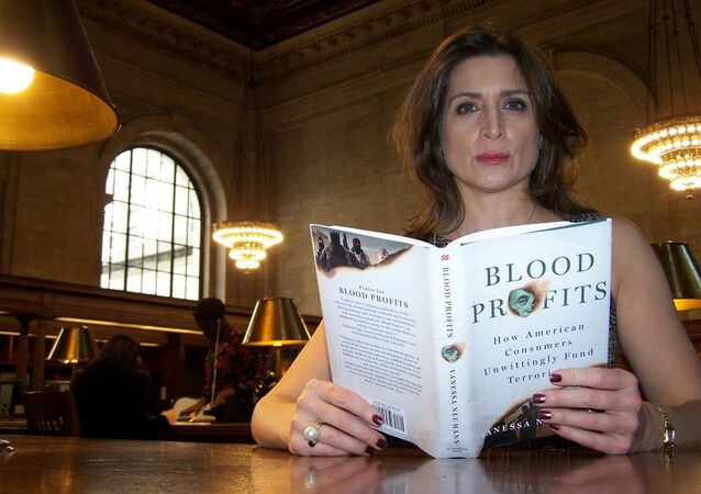 Vanessa Neumann with Her Book