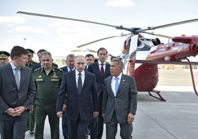 Russian President Vladimir Putin on the site of the inspection of aircraft during a visit to the Kazan Aviation Plant named after S. P. Gorbunov