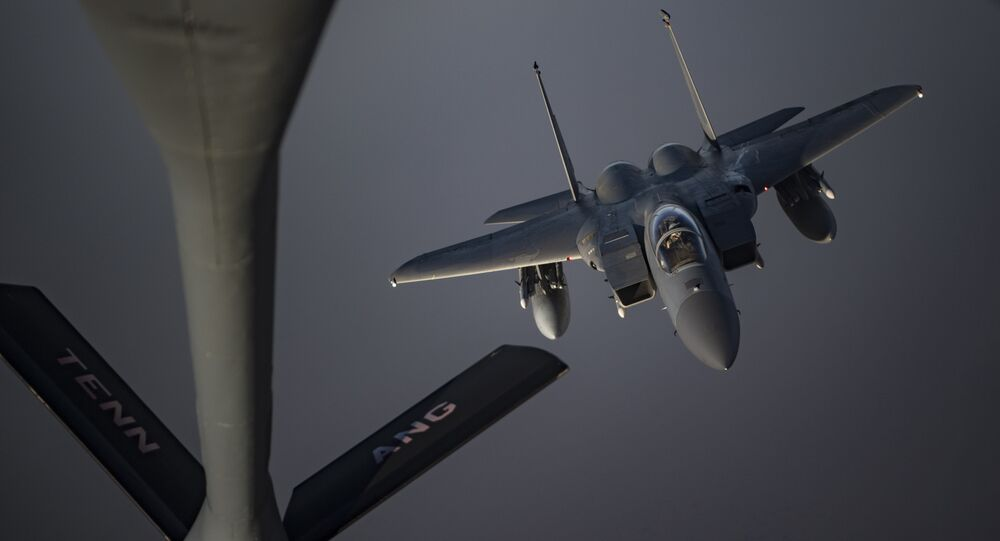 An Airman piloting an F-15C Eagle prepares to receive fuel from a KC-135 Stratotanker from the 28th Expeditionary Aerial Refueling Squadron, May 12, 2019, at an undisclosed location. The 28th EARS maintains constant presence in the U.S. Air Forces Central Command area of responsibility, supporting U.S. and Coalition aircraft in various operations conducted in Iraq, Syria, and Afghanistan.