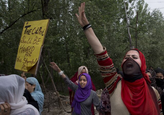 Kashmiri women shout slogans during a protest against the alleged rape of a 3 year old girl from north Kashmir at Mirgund, outskirts of Srinagar, Indian controlled Kashmir, Monday, May 13, 2019