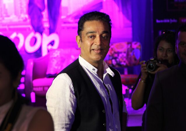 Indian Bollywood actor and director Kamal Haasan waits for a press conference about his latest movie Vishwaroop as part of the three-day long International Indian Film Academy (IIFA) awards Friday June 8, 2012 in Singapore