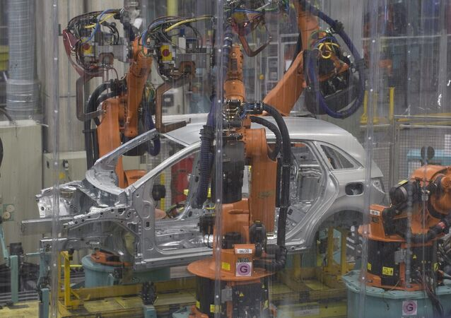 Welding robots at work in the bodywork section of the car manufacturing plant of Mercedes-Benz Manufacturing Hungary Kft., an affiliate of Daimler AG of German carmaker Mercedes-Benz during a journalists' tour in Kecskemet, 85 kms southeast of Budapest, Hungary, Wednesday, May 8, 2013