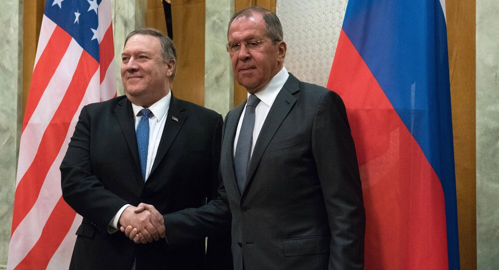 U.S. Secretary of State Mike Pompeo and Russian Foreign Minister Sergey Lavrov shake hands as they pose for a photo prior to their talks in the Black Sea resort city of Sochi, Russia, May 14, 2019