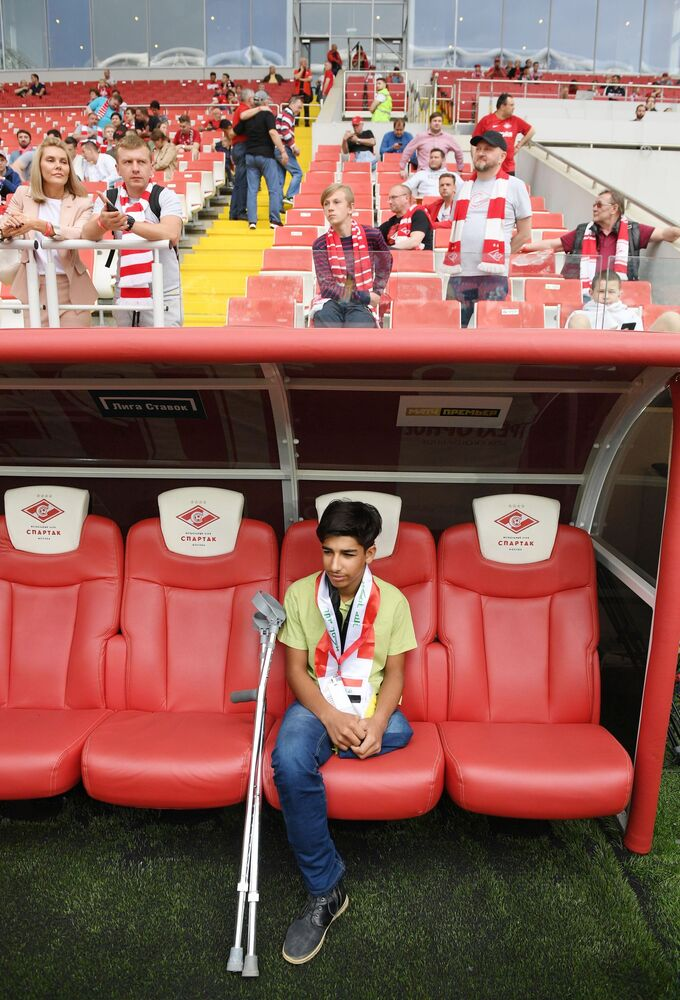 Desire for Life: Iraqi boy Qassem Qadim Attends Football Match in Moscow