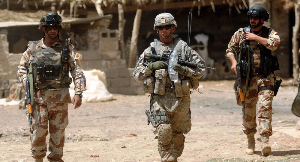 U.S. Army Capt. Eric Morton, center, commander of the 101st Airborne Division's Company B, 1st Battalion, 35th Armor Regiment, walks with Iraqi Maj. Ahmed Hassan and Iraqi 1st Lt. Yasev Mutasam through Shakriyah, Iraq, area during Operation New Town, June 10, 2008