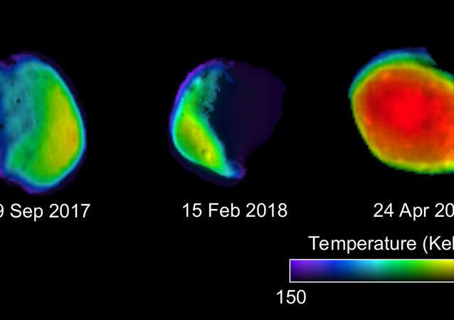 These three views of the Martian moon Phobos were taken by NASA's 2001 Mars Odyssey orbiter using its infrared camera, THEMIS. Each color represents a different temperature range. Credit: NASA