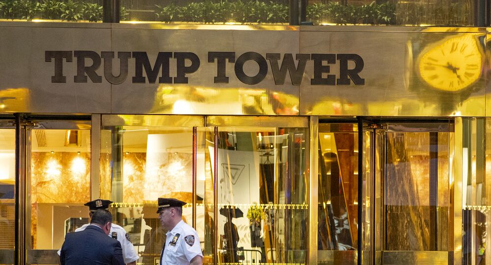 In this July 27, 2018 photo, police investigate the report of a suspicious item inside Trump Tower on Fifth Avenue, in New York