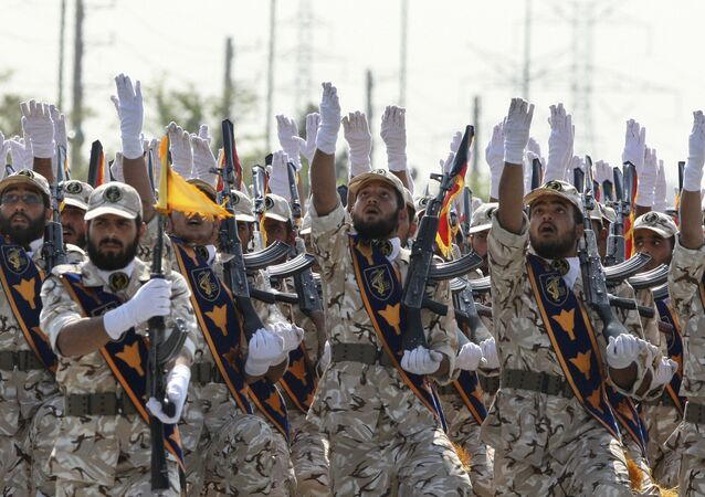 In this Sept. 22, 2011 file photo, Iran's Revolutionary Guard members march during armed forces parade marking the anniversary of the start of the 1980-88 Iraq-Iran war, in front of the shrine of the late revolutionary founder Ayatollah Khomeini, just outside Tehran, Iran